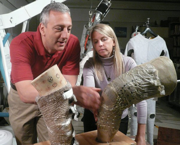 Former NASA astronaut Mike Massimino and Dava Newman review one of the BioSuits. Photo Credit: Julia Cort / WGBH