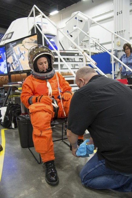 NASA astronaut Serena Aunon is suited up in preparation for fit tests of Bowing's CST-100 spacecraft. Photo Credit: Robert Markowitz