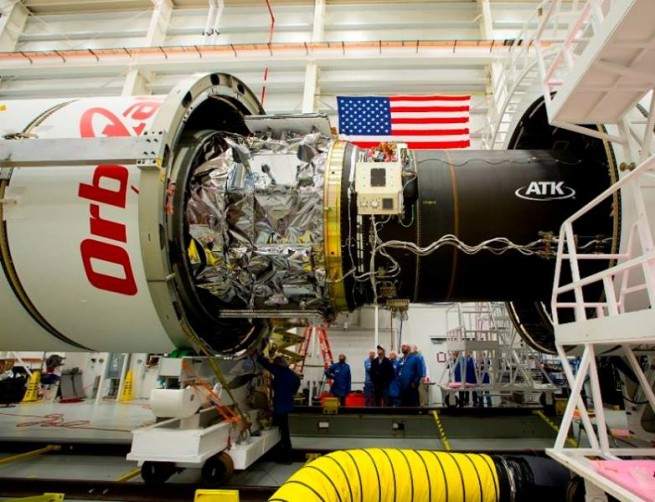 The third stage, with its ATK CASTOR 30 rocket engine are seen being integrated in this image. Photo Credit: Orbital / NASA