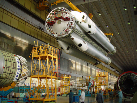The Proton's outboard engines, seen in this archive photo, resemble strap-on solid rocket boosters. Photo Credit: Khrunichev
