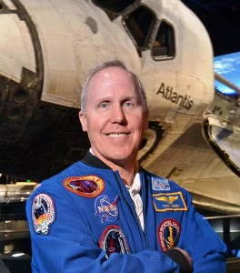Astronaut Tom Jones in front of space shuttle Atlantis Photo courtesy of Tom Jones posted on SpaceFlight Insider