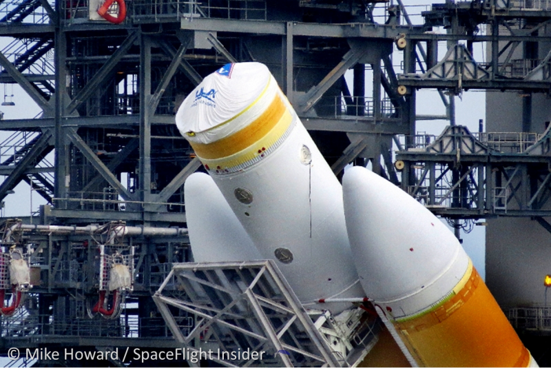 The United Launch Alliance (ULA), Delta IV Heavy booster is raised into position for the EFT-1 mission on Oct. 1, 2014. Photo Credit: Mike Howard / SpaceFlight Insider