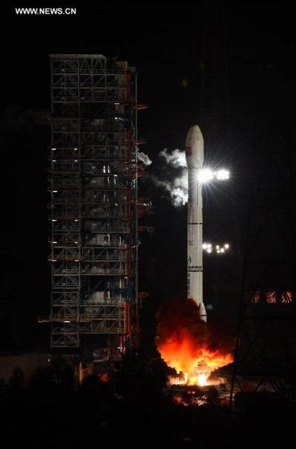 Liftoff of the Long March 3C on its Chang'e 5-T1 mission (photo courtesy Xinhua/ Jiang Hongjing)