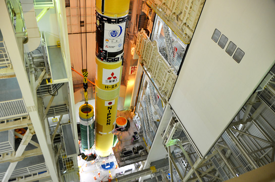 Attaching Solid Rocket Boosters (SRB-As) to H-IIA launch vehicle No.25 (Aug 17/18, 2014). Photo Credit: Mitsubishi Heavy Industries