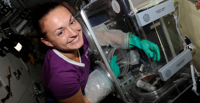 Serova is all smiles as she works diligently to complete her science experiments on the ISS. Photo Credit: NASA/Roscosmos