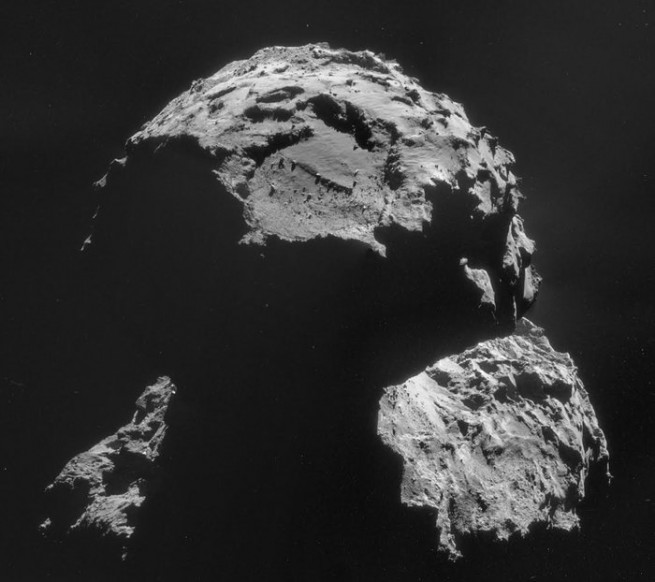 View of the Agilkia landing site as seen by Rosetta. Philae will touch down just above the boulder-shaped depression. Image Credit: ESA