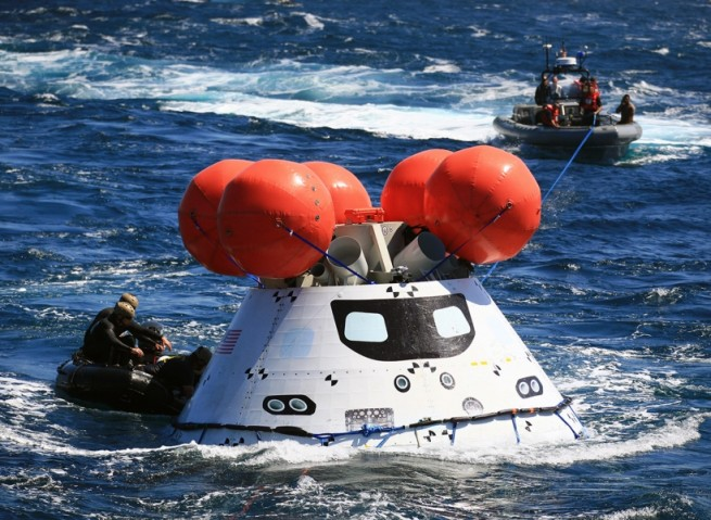 Orion spacecraft recovery U.S. Navy U.S.S. Anchorage Pacific Ocean EFT-1 Exploration Flight Test 1 NASA photo posted on SpaceFlight Insider