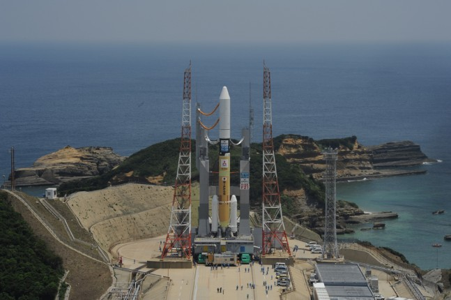 Image of the H-IIA Launch Vehicle No. 21 at the Yoshinobu launch Complex at Tanegashima Space Center. Photo Credit: JAXA as seen on Spaceflight Insider