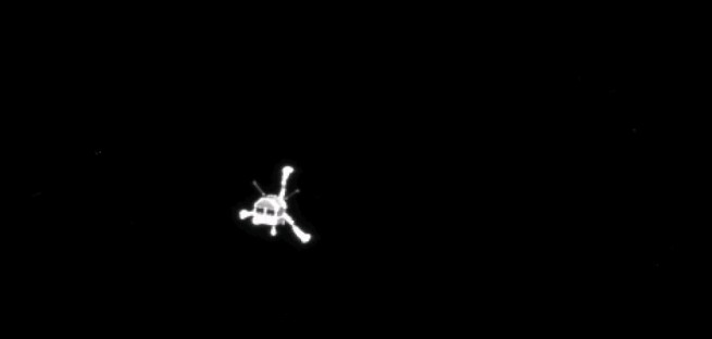 View of the Philae lander on its way to the comet's surface, as seen by Rosetta's OSIRIS camera. Image Credit: ESA