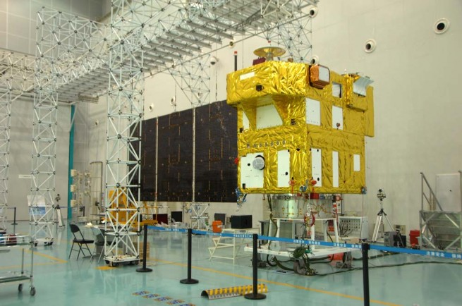 CBERS-4 satellite during construction phase, with one solar panel deployed. Photo Credit: AEB as seen on Spaceflight Insider