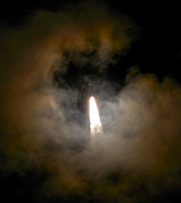 The powerful Atlas V 541 ascends through the clouds as seen on Spaceflight Insider