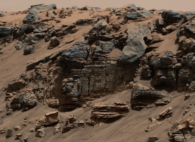 This evenly layered rock photographed by the Mast Camera (Mastcam) on NASA's Curiosity Mars Rover on Aug. 7, 2014, shows a pattern typical of a lake-floor sedimentary deposit not far from where flowing water entered a lake.  Image Credit: NASA/JPL-Caltech/MSSS