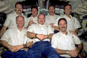 STS-103 Crew. In front are, from left, astronauts  Nicollier, Kelly and Grunsfeld. Behind them are Smith, Foale, Brown, and Clervoy. Photo Credit: NASA. SpaceFlight Insider
