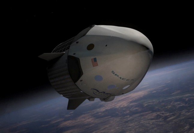 SpaceX image of Dragon v2 spacecraft in orbit above Earth NASA Commercial Crew Program Space Exploraton Technologies image posted on SpaceFlight Insider