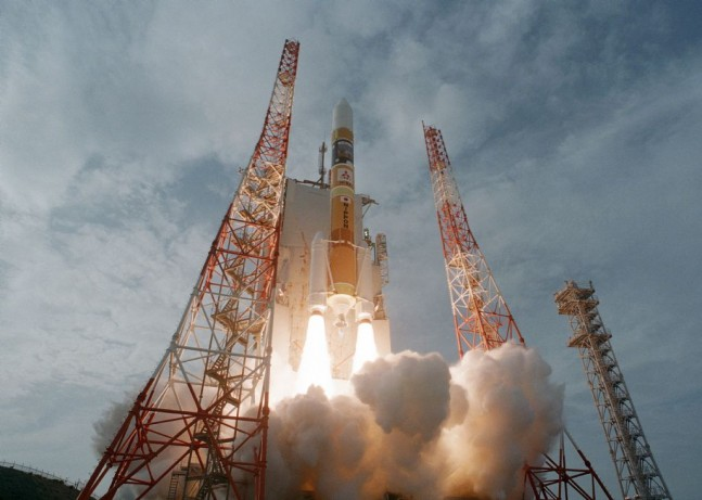 The H-IIA rocket lifts off on a cloudy day for its 17th flight from Tanegashima. Photo Credit: JAXA