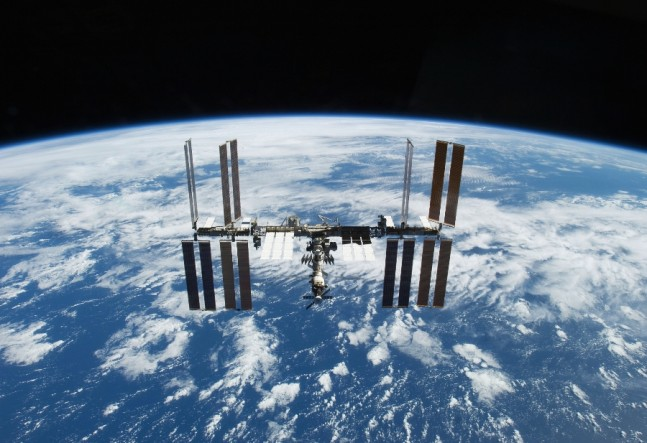 International-Space-Station-over-cloudy-Earth NASA photo posted on SpaceFlight Insider