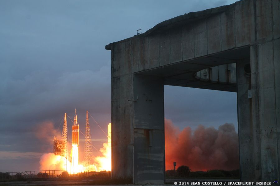 Orion, the future of manned spaceflight, lifts off in the distance as Apollo 1's Launch Complex 34 stands in the foreground. Photo Credit: Sean Costello / SpaceFlight Insider