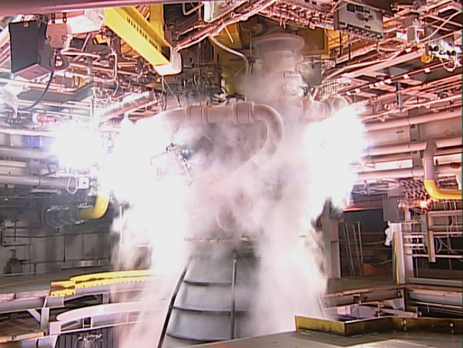 Close-up view inside the A-1 test stand during a hot fire test of the RS-25 engine as seen on Spaceflight Insider