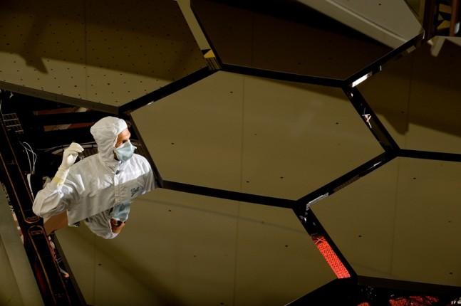 A BALL AEROSPACE TECHNICIAN STANDS WITHIN A JAMES WEBB SPACE TELESCOPE ARRAY THAT WAS IN THE X-RAY AND CRYOGENIC FACILITY FOR TESTING NASA photo posted on SpaceFlight Insider