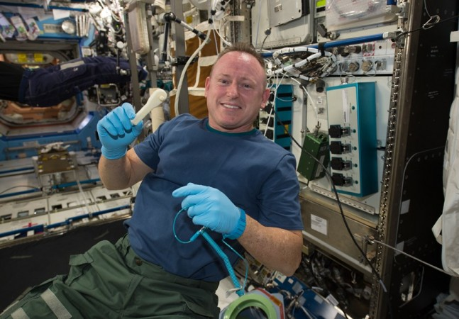International Space Station Expedition 42 crew member NASA astronaut Barry Wilmore NASA photo posted on SpaceFlight Insider