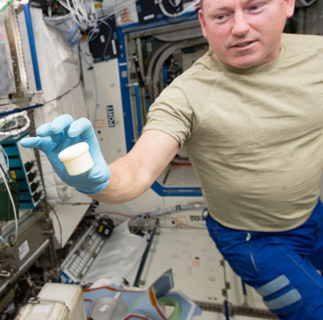 International Space Station Expedition 42 crew member NASA astronaut Barry Wilmore with 3D printed component NASA photo posted on SpaceFlight Insider