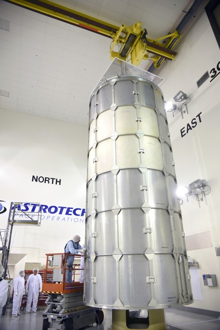 In the Astrotech payload processing facility on Vandenberg Air Force Base in California, technicians secure a transportation canister around NASA's Soil Moisture Active Passive spacecraft for its move to the launch pad. SMAP will launch on a United Launch Alliance Delta II rocket from Space Launch Complex 2 at Vandenberg as seen on Spaceflight Insider