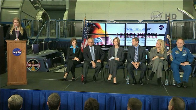 NASA's Stephanie Schierholz introduces the panel of Johnson Space Center Director Dr. Ellen Ochoa, seated, left, NASA Administrator Charles Bolden, Commercial Crew Program Manager Kathy Lueders, Boeing's Jon Elbon, SpaceX's Gwynne Shotwell and NASA astronaut Mike Fincke. Caption and Image Credit: NASA posted on SpaceFlight Insider