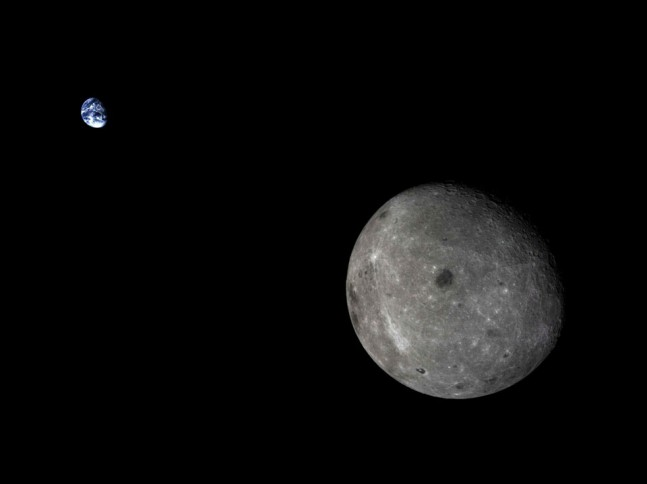 Chang'e 5-T1's captured image from the far side of the Moon, with Earth behind it. Photo Credit: Chinese National Space Administration