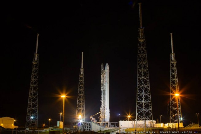 Falcon sits on the pad, waiting to launch into the heavens as seen on Spaceflight Insider