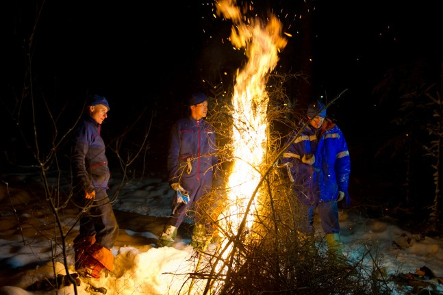 Kathleen Rubins, Takuya Onishi and Anatoly Ivanishin take a survival course in a forest.