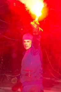 Kathleen Rubins lights a flare during the winter survival training.