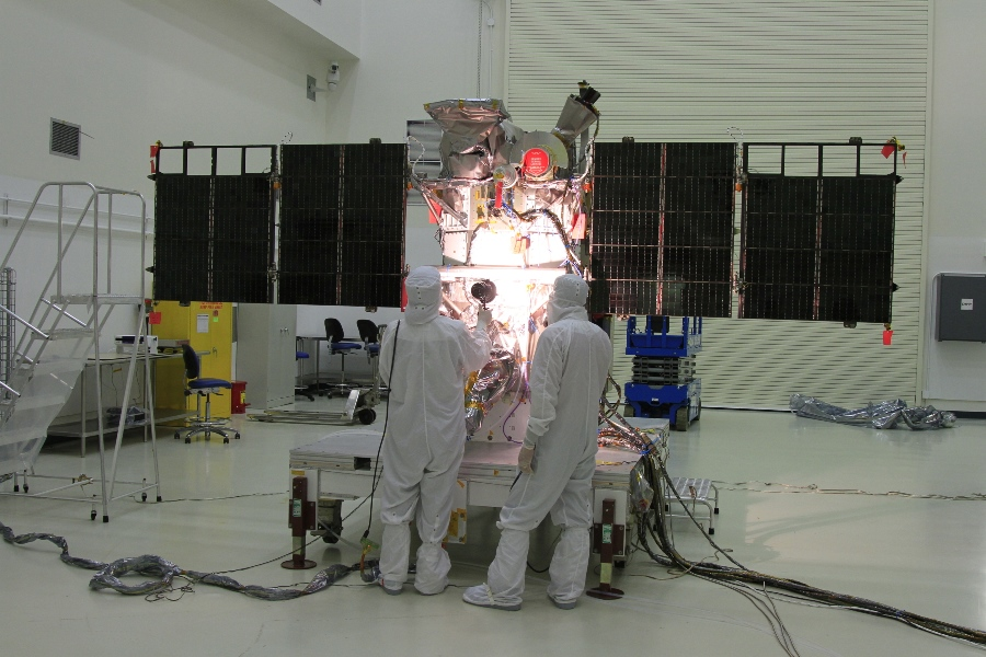 DSCOVR spacecraft in cleanroom with scientists - Copy