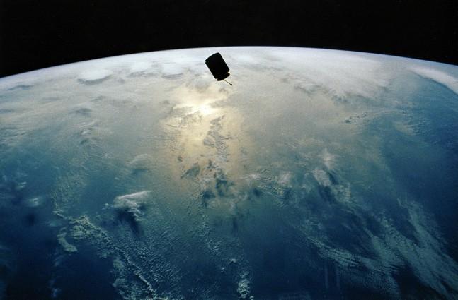Intelsat 603 in orbit above Earth. Photo Credit: NASA