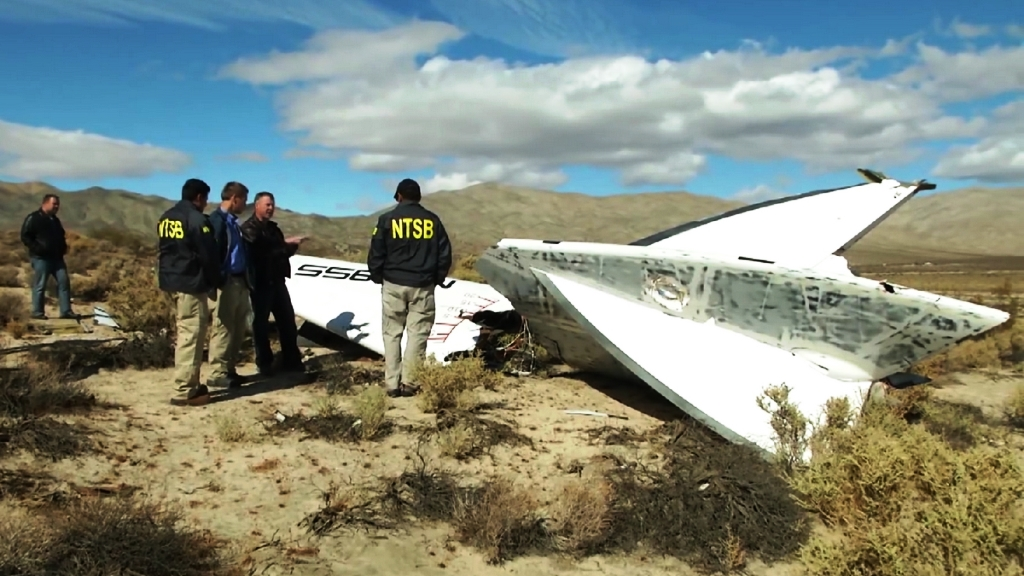 NTSB_Go-Team_inspects_a_tail_section_of_VSS_Enterprise NTSB photo posted on SpaceFlight Insider