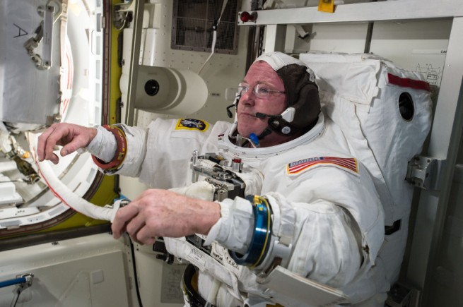 "U.S. astronaut Barry ""Butch"" Wilmore checks out his spacesuit in preparation for a spacewalk. Photo Credit: NASA"