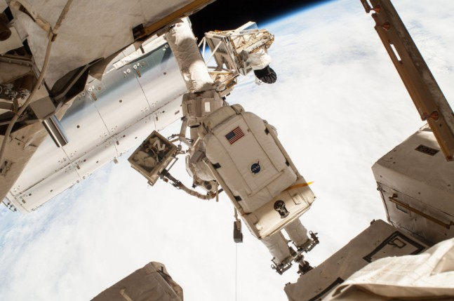 "NASA astronaut Terry Virts, pictured here, and fellow astronaut Barry ""Butch"" Wilmore routed hundreds of feet of cable as part of a reconfiguration of the ISS to enable docking by U.S. commercial crew vehicles. Photo Credit: NASA"