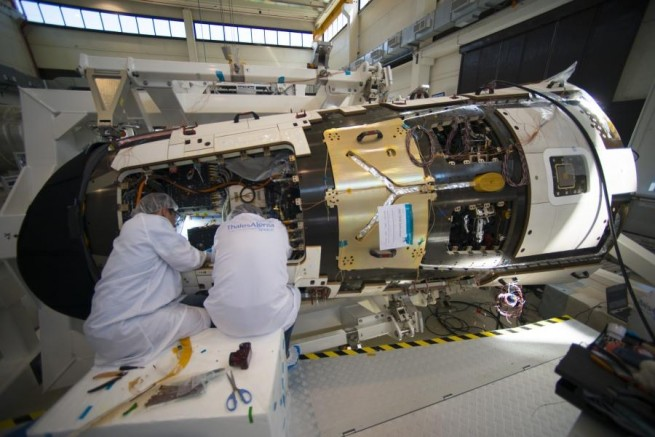 Thales Alenia Space scientists work on ESA's IXV spaceplane.