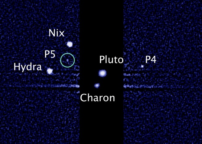 Pluto surrounded by its five moons as seen on Spaceflight Insider
