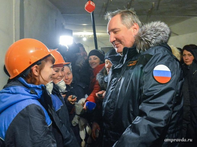 Russian Deputy Prime Minister Dmitry Rogozin talks with workers at the Vostochny cosmodrome construction site.