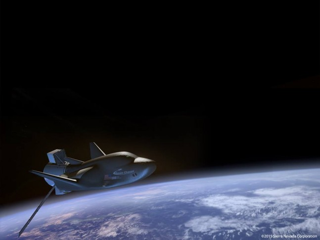 Cargo version of Dream Chaser spacecraft in orbit above Earth. Image Credit: Sierra Nevada Corporation