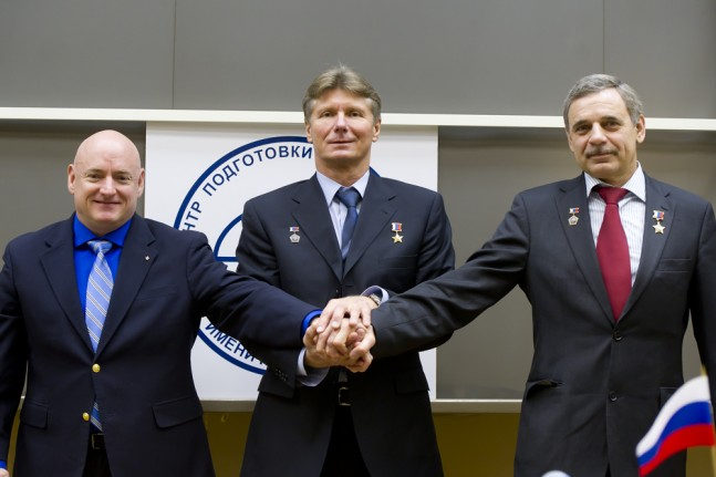 NASA astronaut Scott Kelly (left), and Russian cosmonauts Gennady Padalka (center), Mikhail Kornienko (right) during a press conference in Star City, Russia on Mar. 6, 2015