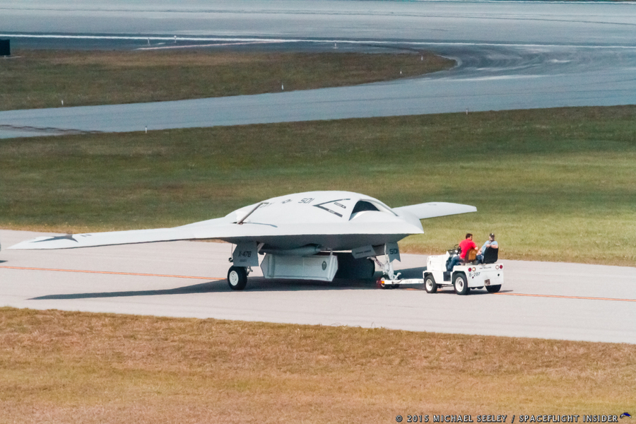 Northrop Grumman's UCAS X-47B UAV (Drone) is towed down one of the runway's at the Melbourne International Airport. Photo Credit: Micheal Seeley / SpaceFlight Insider