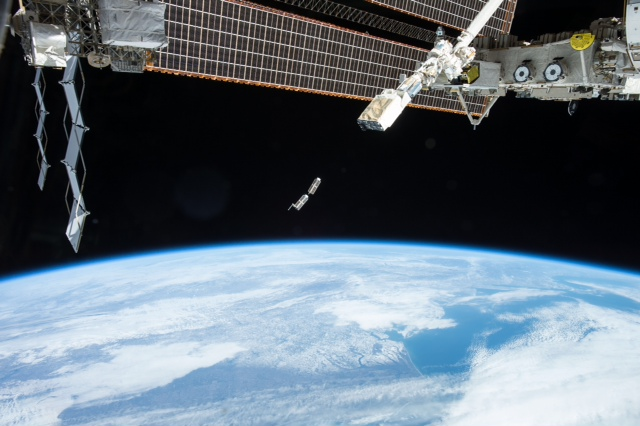 The NanoRacks cubesat dispenser deploying a pair of Planet Labs Dove satellites into orbit from the ISS. Photo Credit: NASA