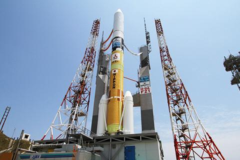 The H-IIA rocket sits on the pad at Yoshinobu Launch Complex on Tanegashima Island. Photo Credit: JAXA