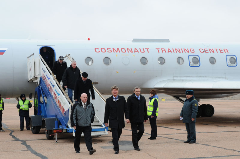 NASA astronaut Scott Kelly (left), Russian Space Agency (Roscosmos) cosmonauts Gennady Padalka (center) and Mikhail Kornienko (right) arrive in Baikonur.