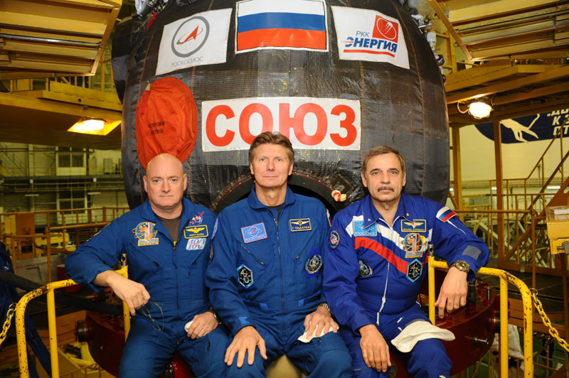 NASA astronaut Scott Kelly (left), Russian Space Agency (Roscosmos) cosmonauts Gennady Padalka (center) and Mikhail Kornienko (right) in front of the Soyuz TMA-16M spacecraft at the Spacecraft Processing Facility in Baikonur.