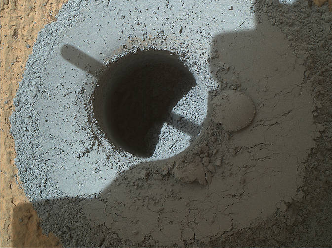 "This hole, with a diameter slightly smaller than a U.S. dime, was drilled by NASA's Curiosity Mars rover into a rock target called ""Telegraph Peak."" The rock is located within the basal layer of Mount Sharp. The hole was drilled on Feb. 24, 2015. Photo Credit:  NASA/JPL-Caltech/MSSS"