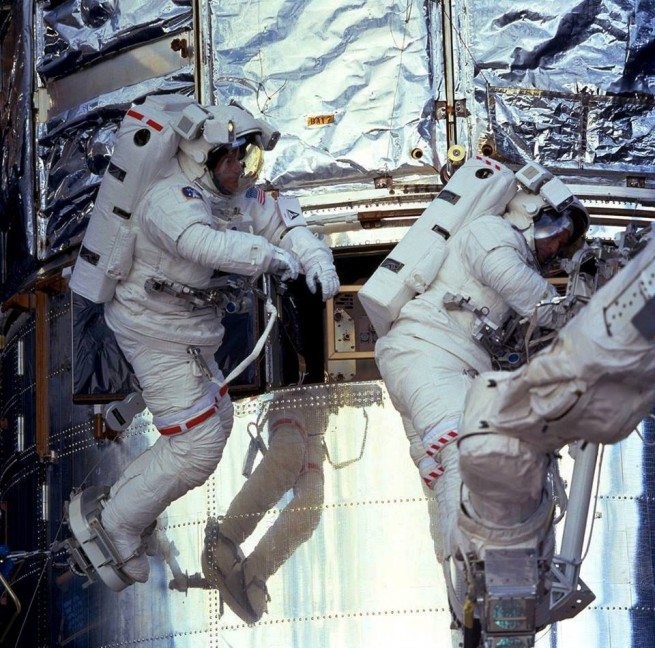 NASA astronauts work to repair and upgrade the Hubble Space Telescope NASA photo posted on SpaceFlight Insider