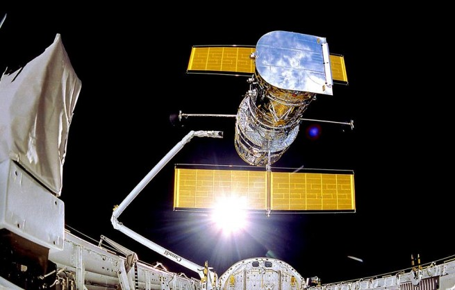 Hubble was deployed by Space Shuttle Discovery in 1990 using Canadarm. Photo Credit: NASA