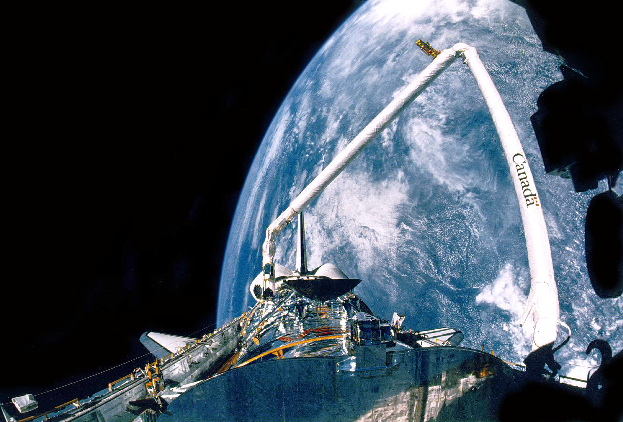 HST Hubble Space Telescope space shuttle Discovery STS-31 Earth NASA photo posted on SpaceFlight Insider